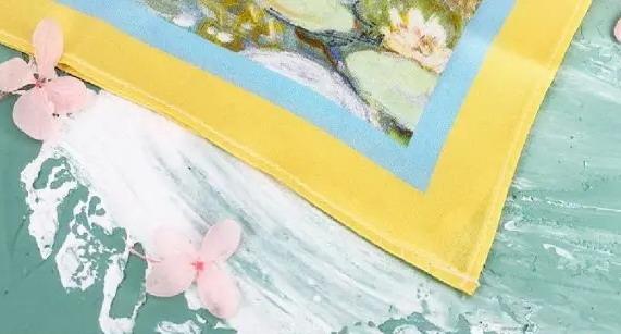 machine serging of custom printed silk scarves